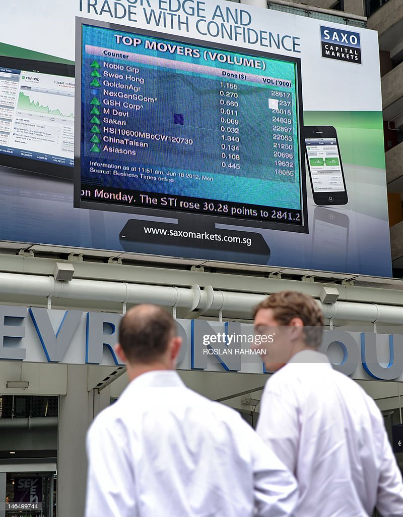 A digital billboard flashes Singapore's top stock movers in the financial district of Singapore on June 18, 2012. Asian markets surged June 18 and the euro rose after Greek pro-austerity parties won enough votes to form a government, but optimism it will stay in the eurozone was tempered with warnings that the future remains uncertain.