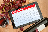 digital Calendar and wine on Digital tablet