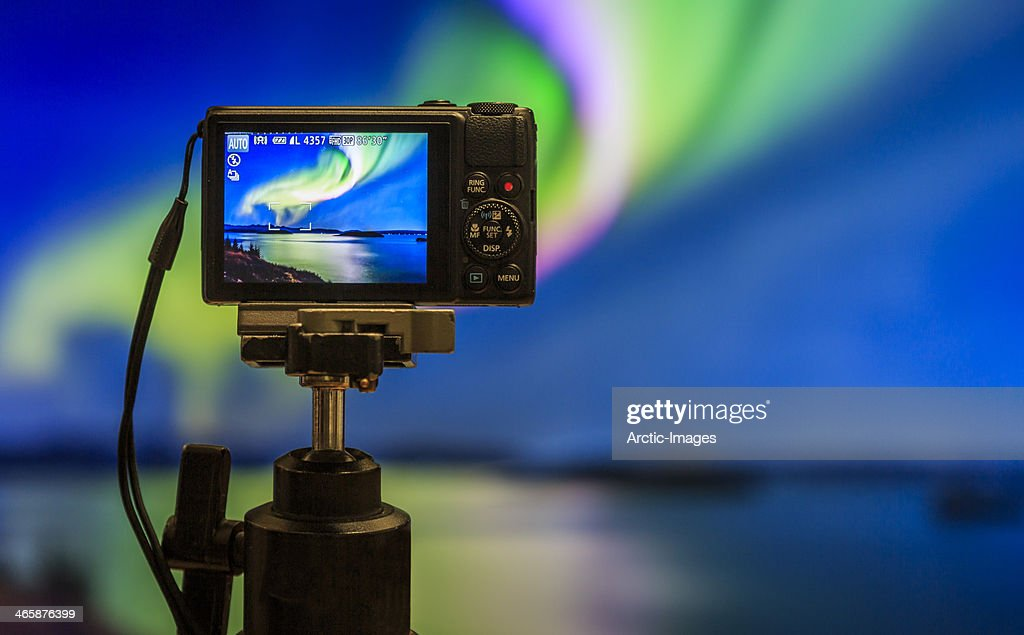 Digital camera on tripod  photographing Auroras. : Stock Photo