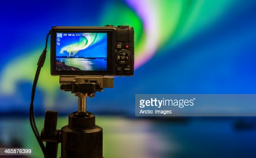 Digital camera on tripod  photographing Auroras. : Stock Photo