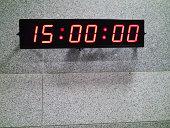 Digital clock on gray patterned wall