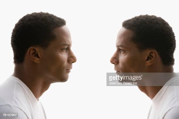 Digital composite of African American man looking at self