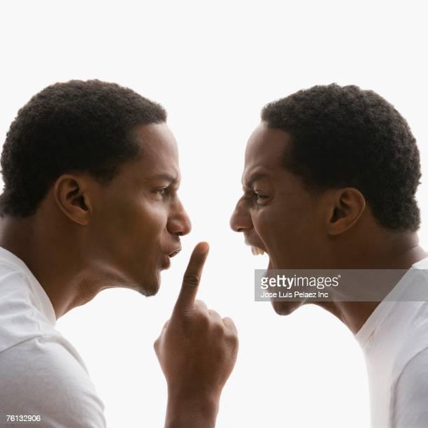 Digital composite of African American man yelling at self