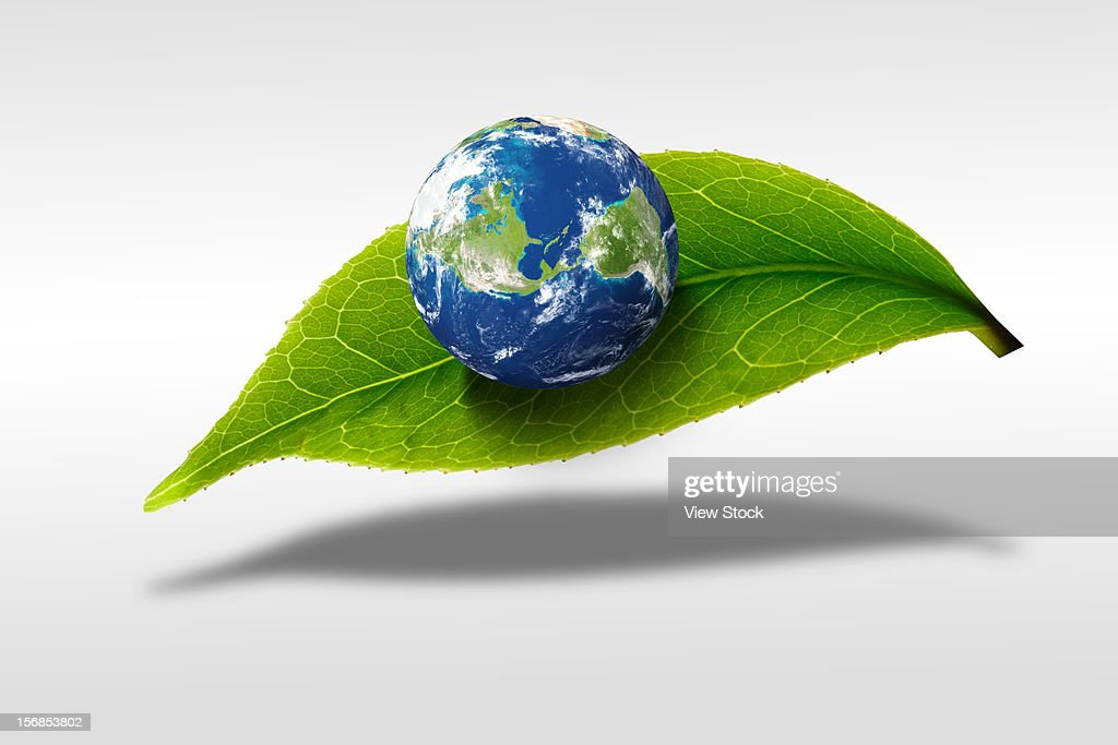 Digital composite of earth and greenn leaf : Stock Photo