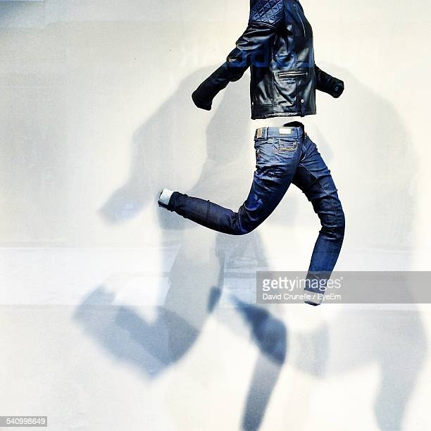 Digital Composite Of Jeans And Jacket Against White Wall