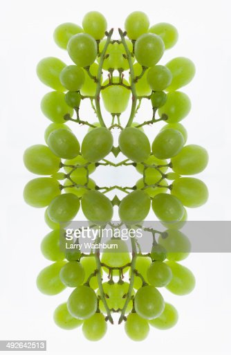 A digital composite of mirrored images of an arrangement of grapes