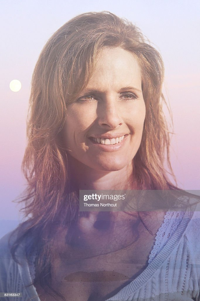 Digital composite of woman and sunrise. : Stock Photo