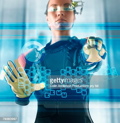 Digital composite of woman using futuristic touch screen : Stock Photo