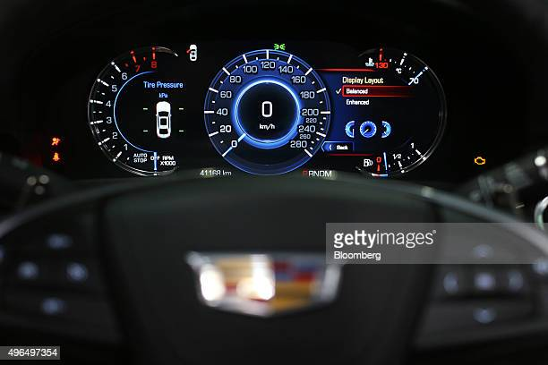 A digital dashboard sits illuminated inside a Cadillac XT5 automobile manufactured by General Motors Co as it sits on display during the Dubai Motor...