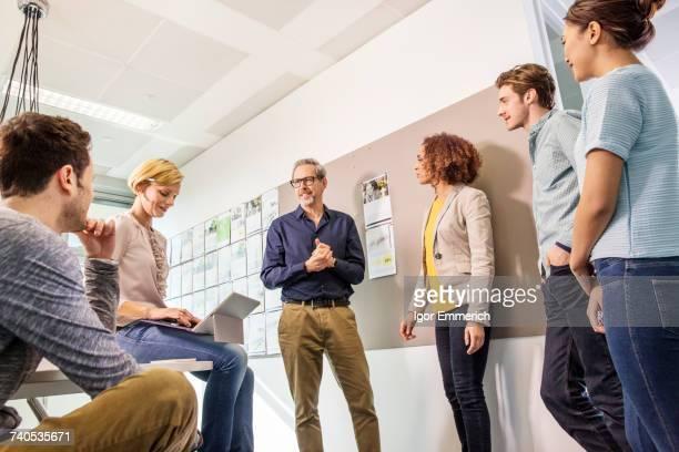 Digital design team talking in office meeting