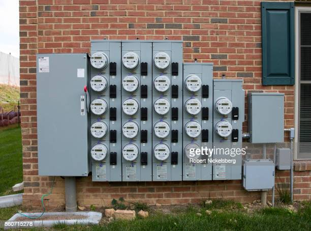 Digital electric meters are displayed on a wall of a residential apartment and townhouse complex in Exton Pennsylvania October 6 2017 In 2016 locally...