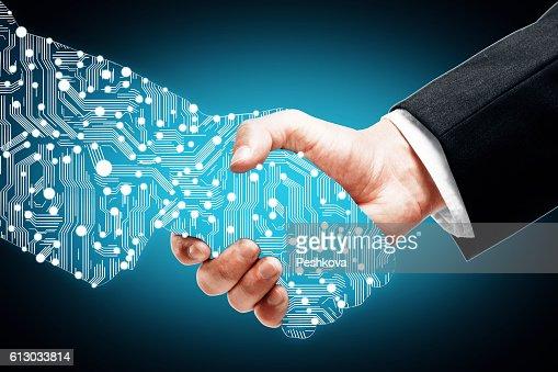 Digital handshake on blue background : Photo