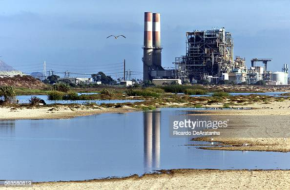 Digital Image taken on Friday Oxnard CA – Photo by ^^^/LAT –– Smoke stacks of the Reliant power plant reflecting on the wetlands of Ormond Beach