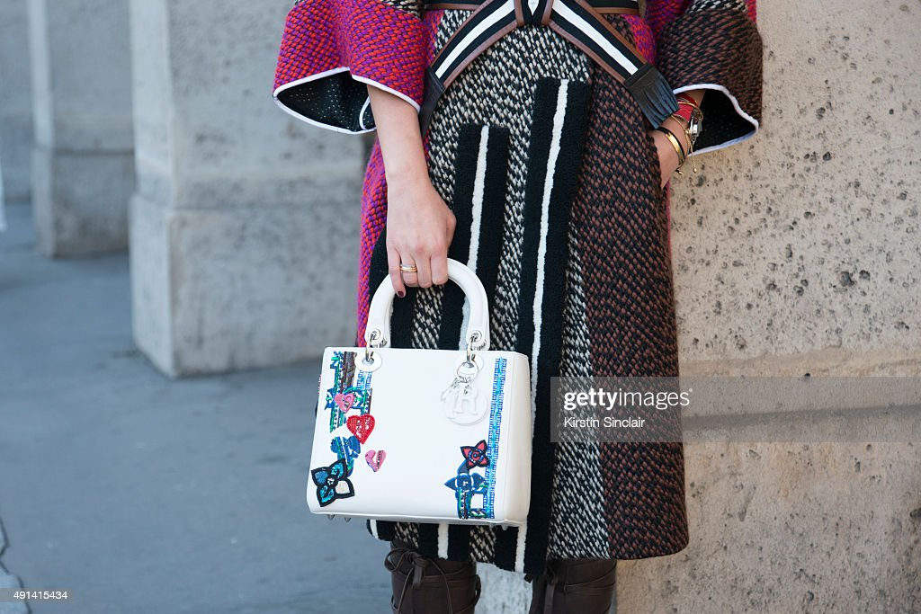 Digital Influencer Camila Carril wears a Dior bag Jimmy Choo shoes and a Fendi coat on day 4 of Paris Collections Women on October 2 2015 in Paris...