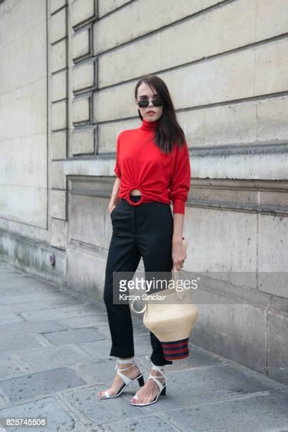 Digital Influencer Evangelie Smyrniotaki wears Celine top and shoes Rosie Assoulin bag Kokkori Optics sunglasses and Dolce and Gabbana trousers day 1...