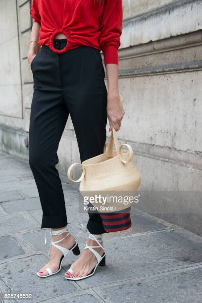 Digital Influencer Evangelie Smyrniotaki wears Celine top and shoes Rosie Assoulin bag and Dolce and Gabbana trousers day 1 of Paris Haute Couture...