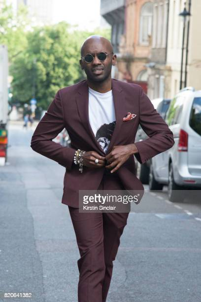 Digital Influencer Geoff K Cooper wears a Moss Bros suit Spektre sunglasses and a Pagara t shirt on day 1 of London Collections Men on June 9 2017 in...