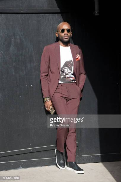 Digital Influencer Geoff K Cooper wears a Moss Bros suit Spektre sunglasses Samsoe and Samsoe shoes and a Pagara t shirt on day 1 of London...