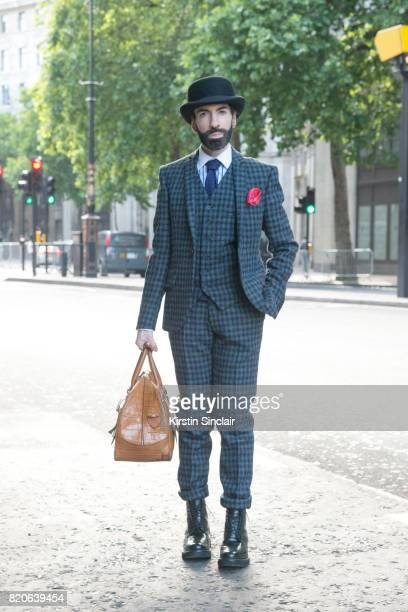 Digital Influencer Jai'me Jan wears Harris Tweed suit Grenson shoes Aspinal of London bag vintage tie Christys hat Hawes and Curtis shirt on day 1 of...