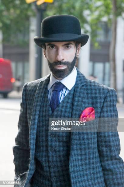 Digital Influencer Jai'me Jan wears Harris Tweed suit vintage tie Christys hat Hawes and Curtis shirt on day 1 of London Collections Men on June 9...