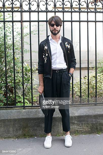 Digital Influencer Kadu Dantas wears a Zara jacket and trainers Armani shirt and trousers Balenciaga bag and Dior sunglasses on day 3 of Paris...
