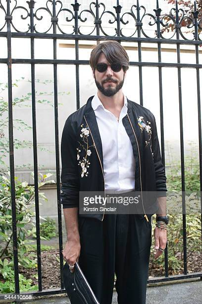 Digital Influencer Kadu Dantas wears a Zara jacket Armani shirt and trousers and Dior sunglasses on day 3 of Paris Collections Men on June 24 2016 in...