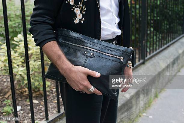 Digital Influencer Kadu Dantas wears a Zara jacket Armani shirt and trousers Balenciaga bag on day 3 of Paris Collections Men on June 24 2016 in...