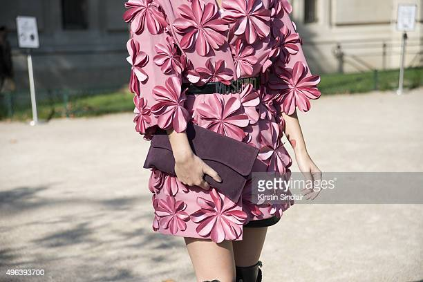 Digital Influencer Linsey Symons wears a Moschino belt Frenchanista clutch Addy Van Krommenacker dress and Santa Che shoes on day 5 during Paris...