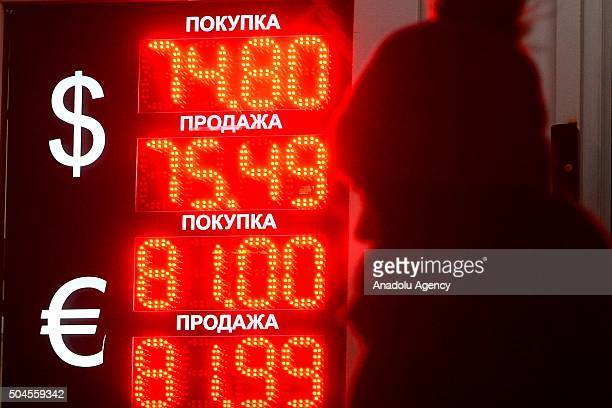A digital information board showing exchange rates of the Russian rouble against the US Dollar and the Euro outside a bureau de change in Moscow...