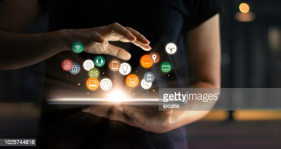 Digital online marketing commerce sale concept. Woman using tablet payments online shopping and icon customer network connection on hologram virtual screen, m-banking and omni channel. : Stock Photo