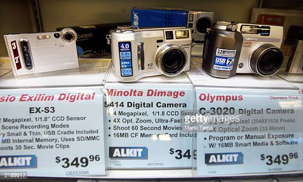 Digital pointandshoot cameras are shown July 23 2003 in New York City Kodak the leading maker of photographic film said it would cut up to 6000 jobs...