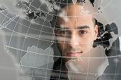 Digital portrait of young man on world map