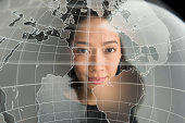 Digital portrait of young woman on world map