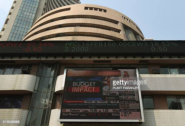 A digital screen relays the budget speech by Indian Finance Minister Arun Jaitley on the facade of the Bombay Stock Exchange in Mumbai on February 29...