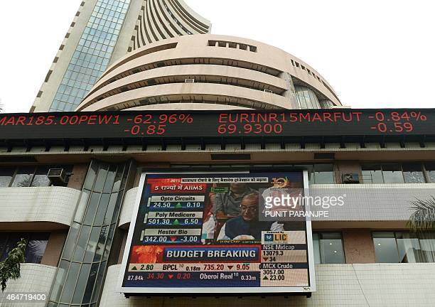 A digital screen shows Indian Finance Minister Arun Jaitley delivering his Budget speech at Parliament in New Delhi at the Bombay Stock Exchange in...