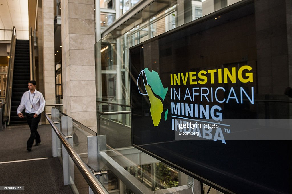A digital screen sits on a conference center wall on the opening day of the Investing in African Mining Indaba in Cape Town, South Africa, on Monday, Feb. 8, 2016. With many miners battling to stay afloat, fewer are willing to shell out 1,140 pounds ($1,641) for the Investing in African Mining Indaba conference in South Africa and business-class airfare. Photographer: Waldo Swiegers/Bloomberg via Getty Images