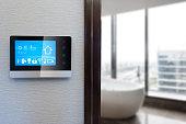 smart screen on wall with modern luxury bathroom