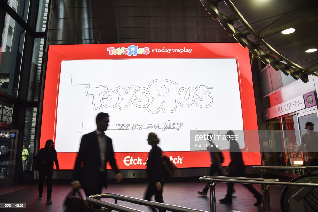 Digital screens showing a giant Etch A Sketch during the 'Toys 'R' Us Takes Over Fulton Street Subway Station with Giant Etch A Sketch,' event at Fulton Subway Station and Fulton Center on October 6, 2017 in New York City.