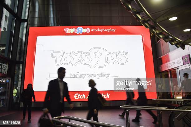 Digital screens showing a giant Etch A Sketch during the 'Toys 'R' Us Takes Over Fulton Street Subway Station with Giant Etch A Sketch' event at...
