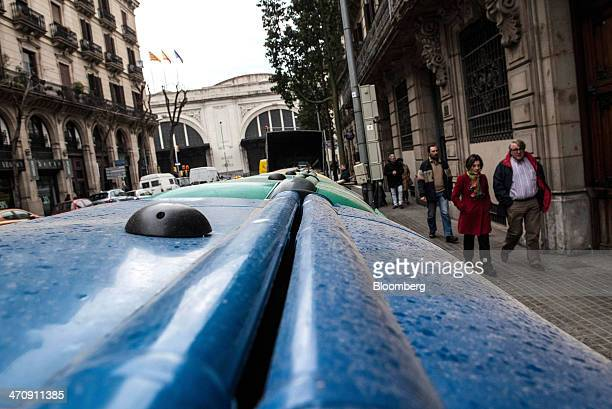 A digital sensor sits on a municipal trash bin to provide real time information on waste levels on a street in Barcelona Spain on Friday Feb 21 2014...