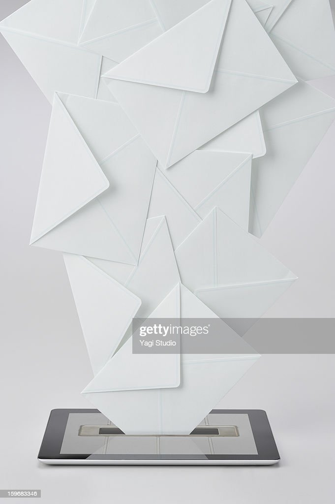 Digital tablet and a lot of mail : Stock Photo