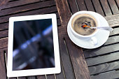 digital tablet and coffee