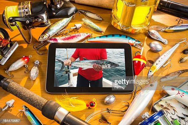 Digital tablet and fishing tackle still-life