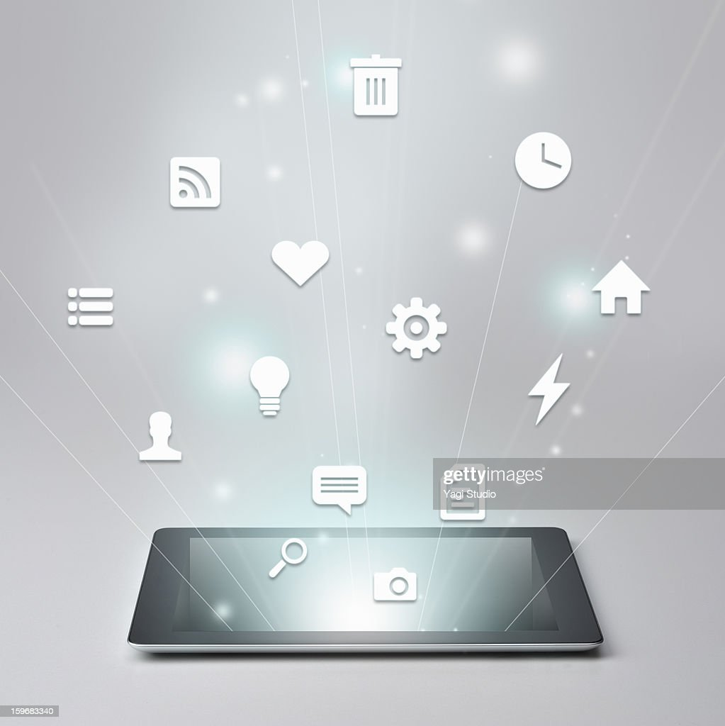 Digital tablet and Variety of icons : Stock Photo