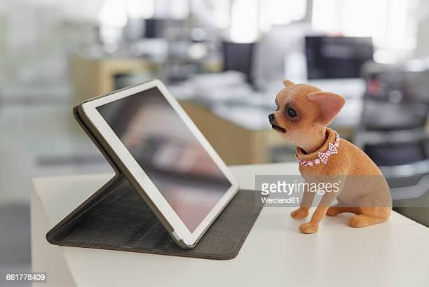 Digital tablet and wobbler on ledger in modern office