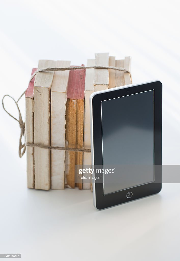Digital tablet by tied books : Stock Photo