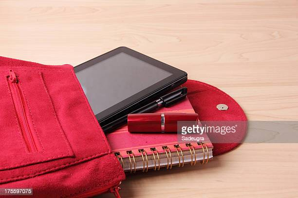 Digital Tablet in  Woman's Bag Backpack