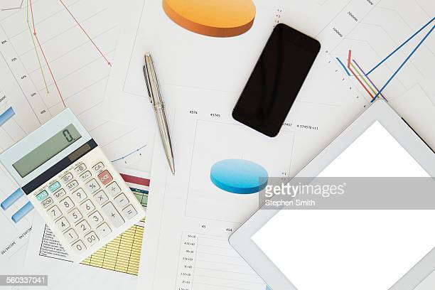 Digital tablet, mobile, calculator and paperwork