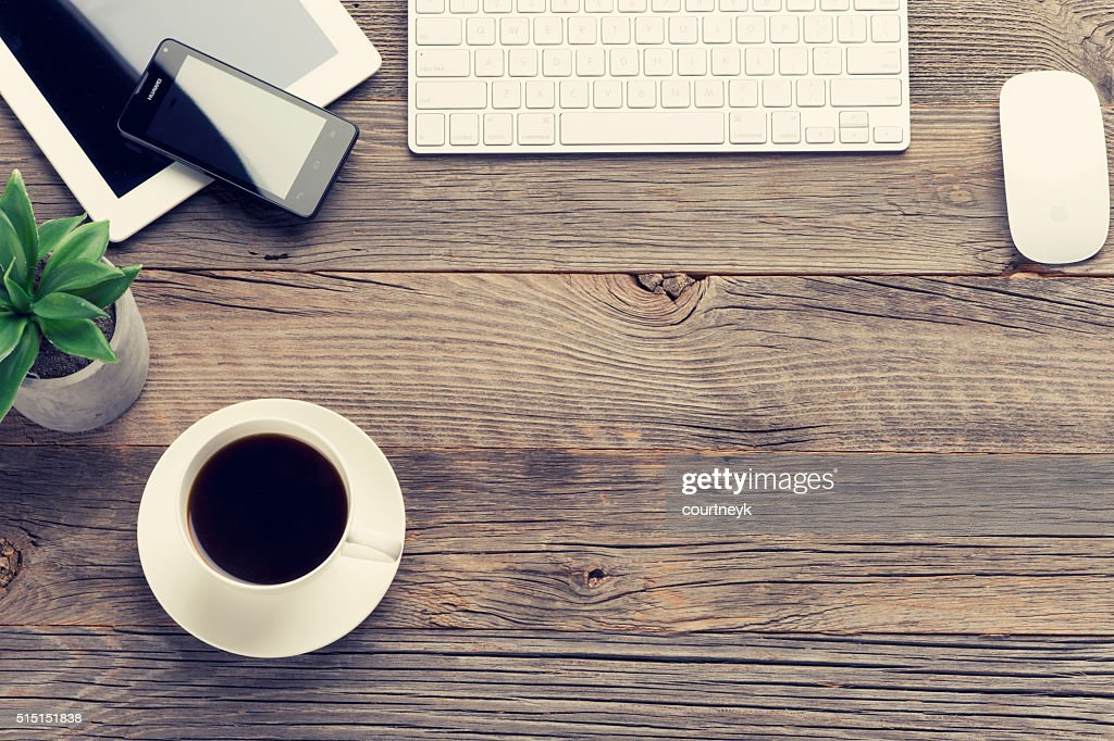 digital tablet, mobile phone and keyboard on wooden table : Stock Photo
