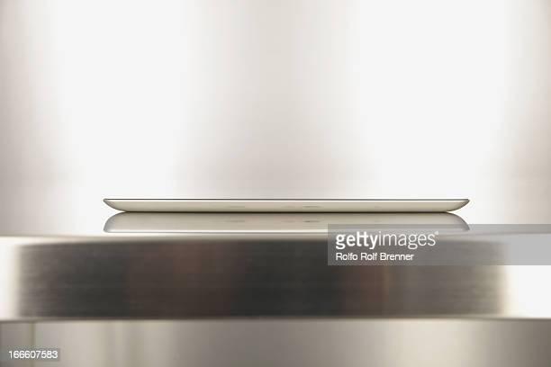 Digital tablet on a metal table